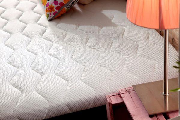 base tapizada detalle acolchado